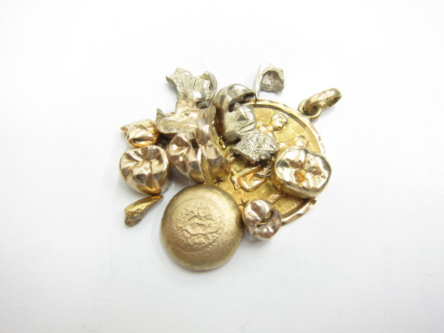 K14金K18金K22金ネックレストップや金歯・金塊総重量33.7g買取いたしました。